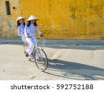 vietnam women ride a bicycle... | Shutterstock . vector #592752188