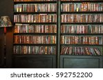 old vintage books in bookcase.... | Shutterstock . vector #592752200