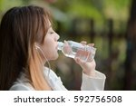portrait of a woman drinking... | Shutterstock . vector #592756508