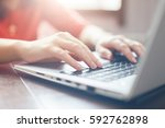 female hands typing on keyboard ... | Shutterstock . vector #592762898