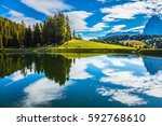 wonderful small lake reflects... | Shutterstock . vector #592768610