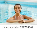 beautiful woman relaxing in the ... | Shutterstock . vector #592783364