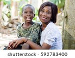 mother and son take  the air in ... | Shutterstock . vector #592783400