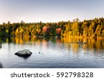Small photo of Majestic Sunset over a Mountain Lake in the Adirondacks, NY, in Autumn