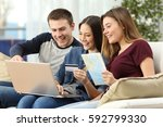 three friends planning and... | Shutterstock . vector #592799330