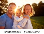 parents with daughter together... | Shutterstock . vector #592802390