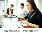 businesswoman in office working ... | Shutterstock . vector #592808024