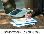 business woman is writing on... | Shutterstock . vector #592833758