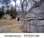 bark covered wigwams at a...   Shutterstock . vector #592835180