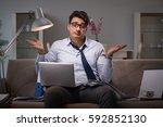 businessman workaholic working...   Shutterstock . vector #592852130