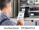 close up of a male technician... | Shutterstock . vector #592864514