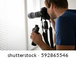 young male holding camera...   Shutterstock . vector #592865546