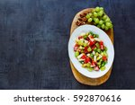 fresh mixed fruit salad with... | Shutterstock . vector #592870616