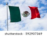 flag of mexico waving in the... | Shutterstock . vector #592907369
