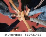 group of people holding hand... | Shutterstock . vector #592931483