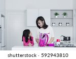 beautiful mother and her... | Shutterstock . vector #592943810