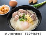 rice porridge with pork and egg ... | Shutterstock . vector #592946969