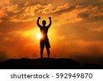 silhouette the winner on top... | Shutterstock . vector #592949870