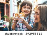 mom with her 6 years old... | Shutterstock . vector #592955516