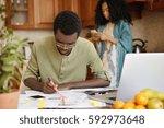 indoor shot of dark skinned man ... | Shutterstock . vector #592973648