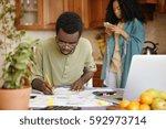 candid shot of serious african... | Shutterstock . vector #592973714