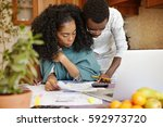 african american husband... | Shutterstock . vector #592973720
