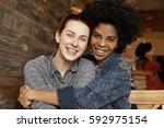 sweet tender indoor shot of... | Shutterstock . vector #592975154