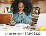 single african american mother... | Shutterstock . vector #592975223