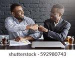 candid shot of happy successful ... | Shutterstock . vector #592980743