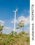 wind turbine on the blue sky... | Shutterstock . vector #592990778
