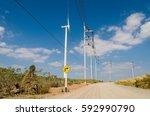 wind turbine on the blue sky... | Shutterstock . vector #592990790