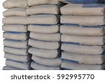 cement bag placed neatly in the ... | Shutterstock . vector #592995770