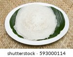 Small photo of Appam / Palappam / plain hoppers made of white rice powder, a popular traditional Kerala breakfast bread eat with masala curry on a houseboat, Alappuzha or Alleppey, India. South Indian food.
