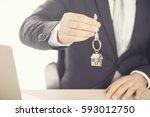 estate agent giving house keys... | Shutterstock . vector #593012750