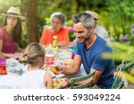 multi generation family having... | Shutterstock . vector #593049224