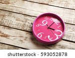 Pink Round Clock On A Grey...