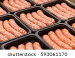 raw meat sausages in packing... | Shutterstock . vector #593061170