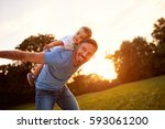 happy young father with son in... | Shutterstock . vector #593061200
