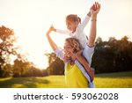 happy mother with daughter... | Shutterstock . vector #593062028
