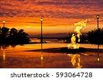 burning eternal flame against... | Shutterstock . vector #593064728