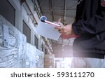 warehouse worker checking his... | Shutterstock . vector #593111270