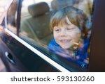 baby boy in the car. | Shutterstock . vector #593130260
