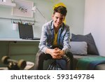 teenage boy sitting  in his room | Shutterstock . vector #593149784