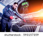 auto mechanic uses a voltmeter... | Shutterstock . vector #593157359