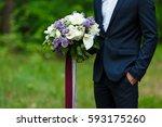 young beautiful groom in dark... | Shutterstock . vector #593175260