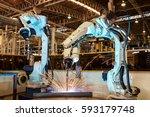 industrial robots are welding... | Shutterstock . vector #593179748