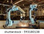 robot are welding assembly part ... | Shutterstock . vector #593180138