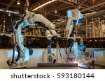 robot are welding assembly part ... | Shutterstock . vector #593180144