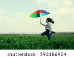 teenage girl jumping in the... | Shutterstock . vector #593186924