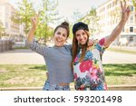 two happy young female students ... | Shutterstock . vector #593201498